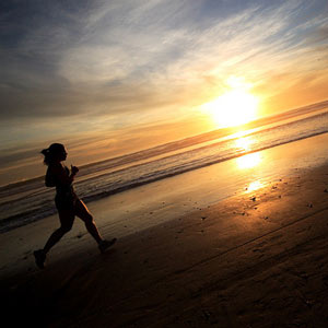 jogging along the beach for exercise