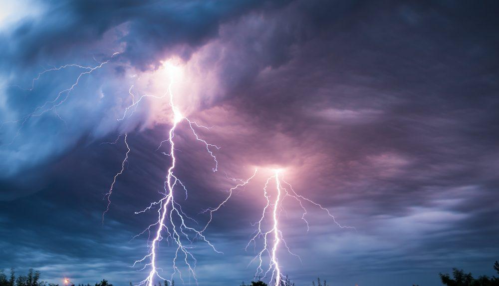 Lightning bolts from an evening sky