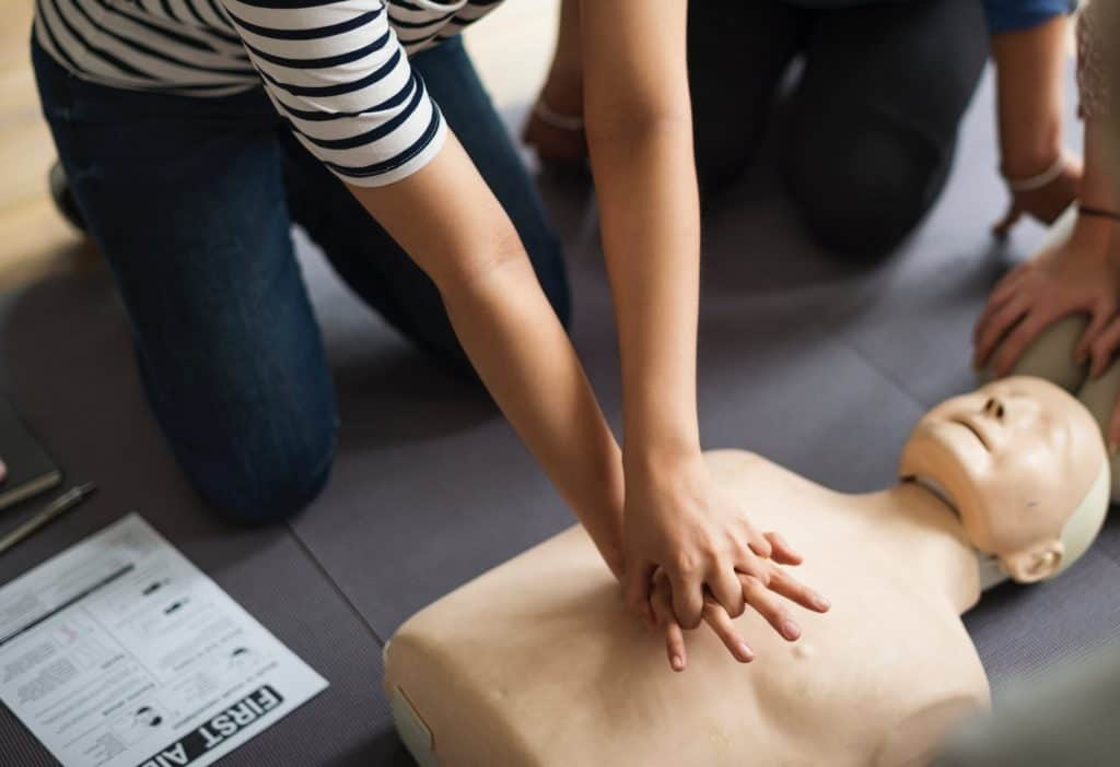 practicing CPR in a course