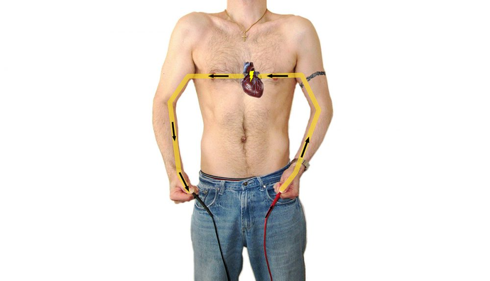 electrocution threat to the heart of bare chested man
