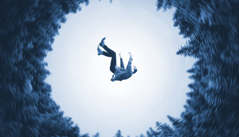 suicide illustrated by man's body falling into an abyss